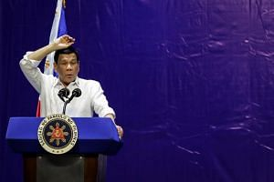 Philippine President Rodrigo Duterte gestures as he speaks at the Barangay Summit on Peace and Order with village officials in Manila, Philippines, on Jan 8, 2019.