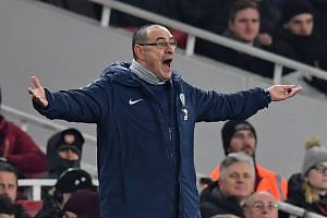 Chelsea's Italian head coach Maurizio Sarri gestures on the touchline during the match.