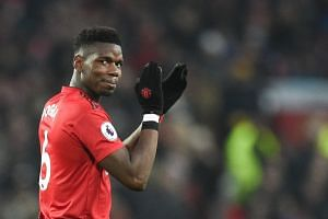 Manchester United's French midfielder Paul Pogba reacts during the match.