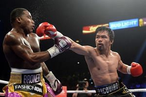 Manny Pacquiao throwing a punch at Adrien Broner during their WBA welterweight world title boxing match on Jan 19, 2019.
