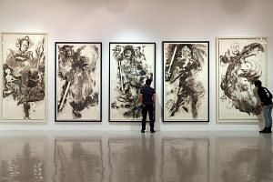 Exhibitions taking place during the ongoing Singapore Art Week include Artcommune's latest show at Artspace@ Helutrans, featuring Singapore artist Tang Da Wu's larger-than-life Chinese ink paintings (above) and artist Andre Wee's Within Without: A So