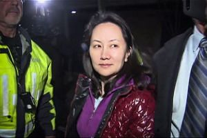 Television screengrab showing Meng Wanzhou as she exits a court registry in Vancouver, British Columbia, on Dec 11, 2018.