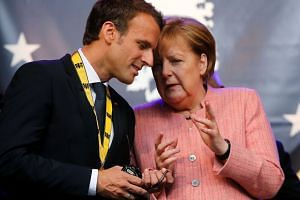 While Chancellor Angela Merkel (right) is now serving out her final term, President Emmanuel Macron has battled the rise of the yellow vest protest movement and plummeting approval ratings.