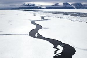 A pathway opening in landfast sea ice, in Dijmhna Sund, Nioghalvfjerdsfjorden, in Greenland. New research shows that the ice loss in Greenland is speeding up as warming increases.