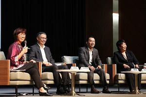 (From left) Panel moderator and Singapore Management University Professor Annie Koh at the business outlook forum yesterday with UOB head of research Suan Teck Kin, DBS senior economist Irvin Seah and OCBC Bank head of treasury research and strategy