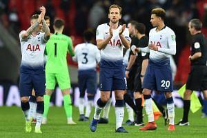 Tottenham's (from left) Kieran Trippier, Harry Kane and Dele Alli applaud fans after a match.