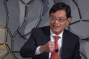 Mr Heng Swee Keat speaking at the World Economic Forum in Davos.