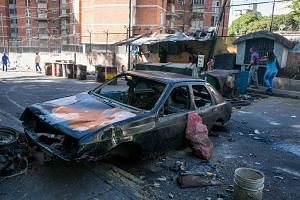 View of a vehicle burned down on a street where there were protests in Caracas, Venezuela, on Jan 22, 2019.