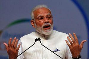 India's Prime Minister Narendra Modi speaks during a summit in Gandhinagar, India, on Jan 18, 2019.