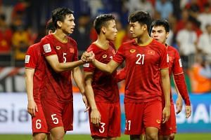 Vietnam's Doan Van Hau, Thanh Chung Nguyen and team mates look dejected at the end of the match.