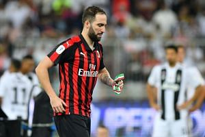 AC Milan's Gonzalo Higuain reacts after the match between AC Milan and Juventus at the Italian Super Cup on Jan 16, 2019.