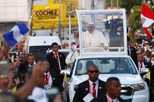 Pope Francis waves from his Popemobile as he arrives for World Youth Day in Panama City on Jan 23, 2019.