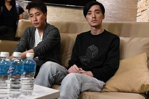 Aloysius Pang's talent manager Dasmond Koh (left) and the late actor's second-eldest brother, Kenny, speaking to members of the media at Changi Airport on Jan 24, 2019.
