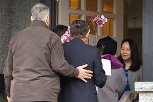 Meng Wanzhou (right) answers the door to individuals carrying flowers after she was released on bail.