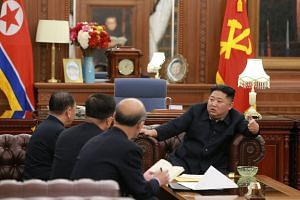 North Korean leader Kim Jong Un (right) talking with delegates sent to the US for high-level talks.