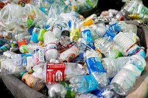 Used plastic bottles are seen at a waste collection point in Tokyo, Japan, on Nov 21, 2018.
