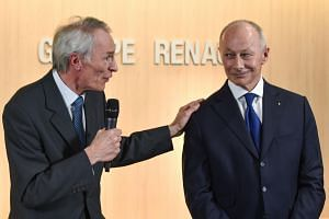 French carmaker Renault's newly appointed board chairman Jean-Dominique Senard (left) delivers a speech next to new chief executive Thierry Bollore during a press conference at the Renault headquarters in Boulogne Billancourt, near Paris on Jan 24, 2
