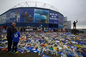 A display of Cardiff City scarves and jerseys, flowers, messages and other tributes to Emiliano Sala.