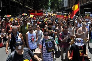 """Protesters marching through the streets of Sydney in an """"Invasion Day"""" rally on Australia Day, on Jan 26, 2019."""
