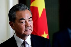 "Foreign Minister Wang Yi urged nations not to use ""fabricated"" excuses to block the Chinese telecoms giant."