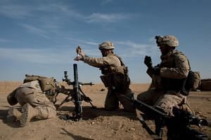 US Marines prepare to fire on a Taliban position near Marja, Afghanistan, on Feb 17, 2010.
