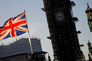 A Union flag flies from a pole near the Elizabeth Tower, commonly known as Big Ben, at the Houses of Parliament in central London, on Jan 28, 2019.