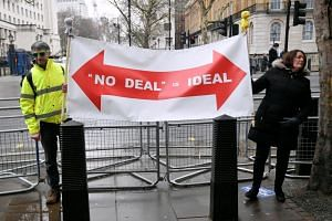 Pro-Brexit campaigners stand outside Downing Street in London, Britain, on Jan 24, 2019.