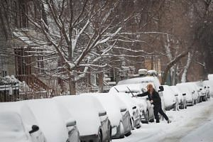 Residents of Chicago dig out after a snowstorm passed through the area on Jan 19, 2019, in Chicago, Illinois.