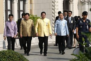 Four ministers of Thai Prime Minister Prayut Chan-o-cha's government - (from left) minister in the prime minister's office Kobsak Pootrakool, minister of science and technology Suvit Maesincee, minister of industry Uttama Savanayana and minister of c