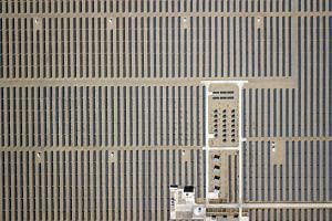 Photovoltaic panels stand at a solar power station at the Golmud Solar Park in this aerial photograph taken on the outskirts of Golmud, Qinghai province, China, on July 24, 2018.