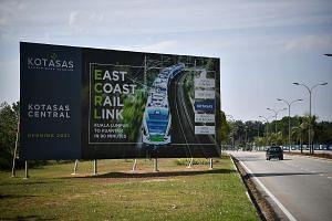 A billboard sign publicising the RM81 billion (S$27 billion) East Coast Rail Link project at Kota Sultan Ahmad Shah in Kuantan, Pahang.