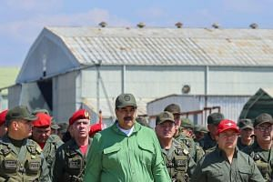 Venezuelan President Nicolas Maduro he was ready to sit down for talks with the country's opposition and was open to the possibility of third countries mediating on Jan 30, according Russia's RIA news agency.