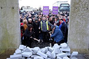 Protesters destroying a mock wall erected during an anti-Brexit demonstration last Saturday at a road crossing the border between Northern Ireland and Ireland