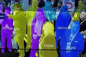 A demonstration using artificial intelligence and facial recognition in dense crowd spatial-temporal technology at CES 2019 in Las Vegas earlier this month. The writer says deep learning, deep surveillance, deep facial recognition, deep voice recogni