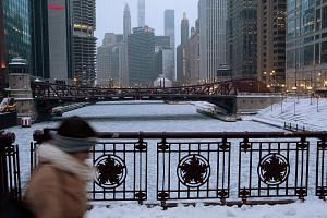 The Chicago River in Chicago, Illinois, was filled with chunks of ice. A low of -23 deg C was forecast in the city yesterday.