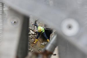 A worker at a construction site along Sims Avenue, on Jan 18, 2019.