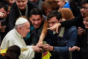 Pope Francis meeting the faithful at the Vatican yesterday. His impending visit to the UAE is aimed at building bridges amid growing nationalism and insularism around the world, said its minster for tolerance.