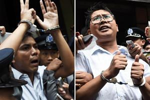 File photos of Reuters journalists Kyaw Soe Oo (left) and Wa Lone being escorted by police after their sentencing by a court to jail in Yangon on Sept 3, 2018.