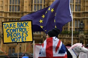 A campaigner on the issue of Brexit attends a rally outside Parliament in London.