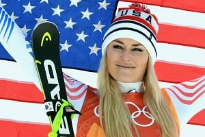 Vonn celebrates winning bronze medal for the Women's Downhill race during the 2018 winter Olympics in South Korea.