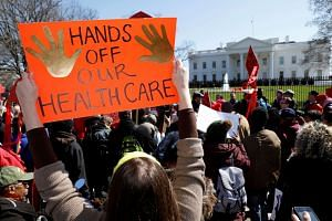 Protesters demonstrate against US President Donald Trump and his plans to end Obamacare outside the White House.