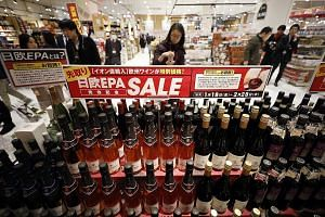 Supermarkets like this one in Chiba, near Tokyo, have already cut prices on imported wines from the European Union. With the trade deal, European consumers can enjoy cheaper Japanese products such as sake and beef.