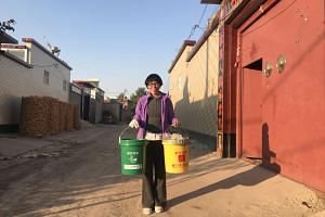 Chen Liwen makes her rounds to help people recycle in Xicai Village in Hebei province, outside Beijing, China.
