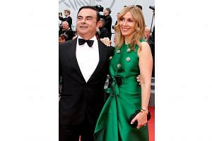 Former Nissan chief executive officer and former Renault-Nissan Alliance chairman and CEO Carlos Ghosn, with his wife Carole (both left) at the 70th Cannes Film Festival in 2017, has spent more than 70 days in jail and been refused bail twice.