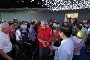 Prime Minister Lee Hsien Loong greeting attendees at the Merdeka Generation event at Gardens by the Bay.