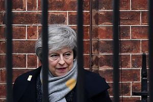 Theresa May departs 10 Downing Street in London following a Cabinet meeting on Feb 5, 2019.
