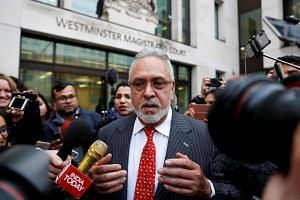 Vijay Mallya leaves court after an extradition hearing in December 2018.