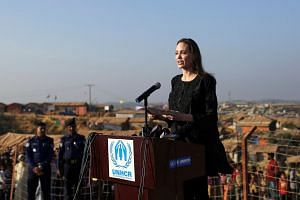 Angelina Jolie joins in a press briefing as she visits Kutupalong Rohingya refugee camp in Cox's Bazar, Bangladesh.