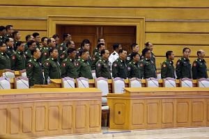 Military representatives attend a regular session of the Union Parliament in Naypyitaw, Myanmar, on Feb 5, 2019.