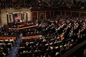 Republicans stand and applaud as US President Donald Trump delivers his second State of the Union address to a joint session of the US Congress in the House Chamber, on Feb 5, 2019.
